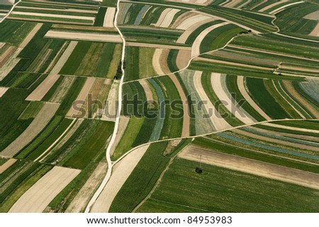 AERIAL TEXTURE FROM ABOVE SUMMER   GREEN AND BROWN FIELD - stock photo