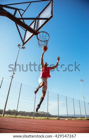 African american basketball player scoring a point. - stock photo