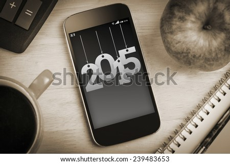 2015 against overhead of smartphone screen - stock photo