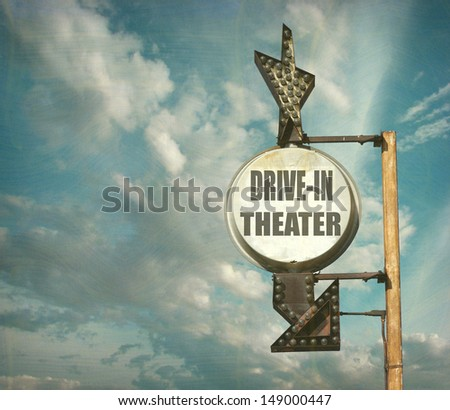 aged and worn vintage drive-in theater sign                               - stock photo