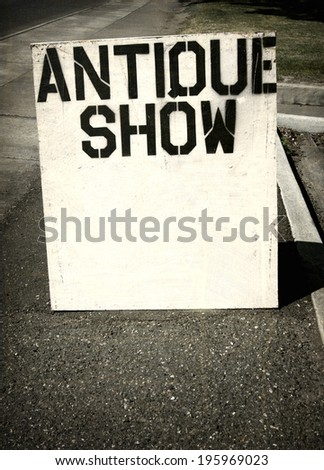 aged and worn vintage photo of  antique show sign                            - stock photo