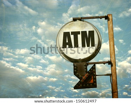 aged and worn vintage photo of atm sign                               - stock photo