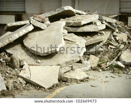 aged and worn vintage photo of concrete rubble - stock photo