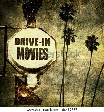 aged and worn vintage photo of drive in movie sign                             - stock photo