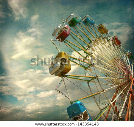 aged and worn vintage photo of ferris wheel - stock photo