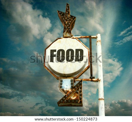 aged and worn vintage photo of food sign with arrow                               - stock photo