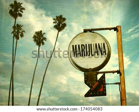 aged and worn vintage photo of marijuana sign with palm trees                               - stock photo