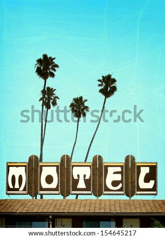 aged and worn vintage photo of motel sign with palm trees                              - stock photo