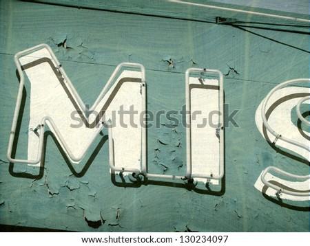 aged and worn vintage photo of  neon sign - stock photo