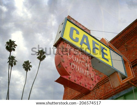 aged and worn vintage photo of  old neon cafe sign with palm trees                             - stock photo