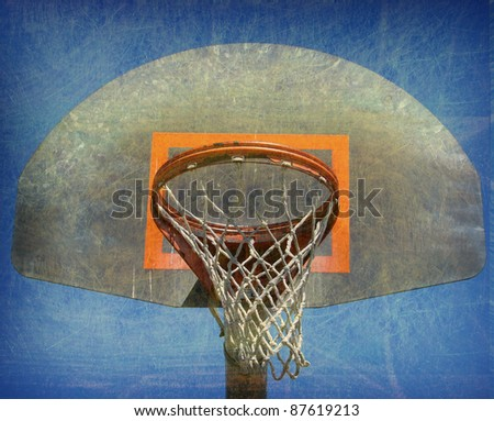 aged and worn vintage photo of  outdoor basketball hoop - stock photo