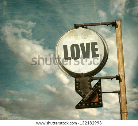 aged and worn vintage sign with love message - stock photo