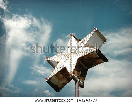 aged and worn vintage star neon sign - stock photo