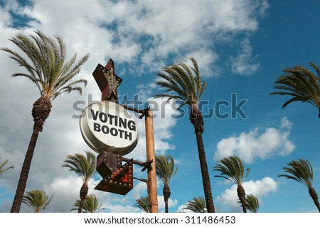 aged and worn vintage voting booth sign                               - stock photo