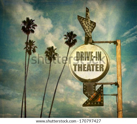 agerd and worn vintage photo of  drive in theater sign with arrow                             - stock photo