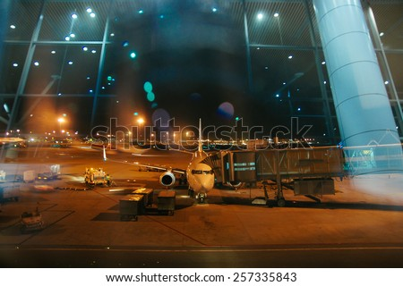 airplane near the terminal ready to boarding for night flight  - stock photo