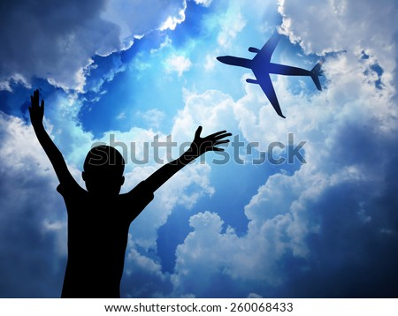 Airplane on blue sky background     - stock photo