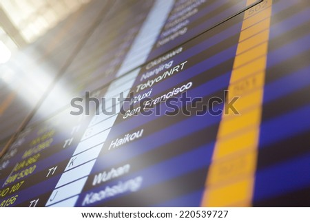 Airport arrival board in airport terminal. Travel concept. San Francisco in focus. - stock photo