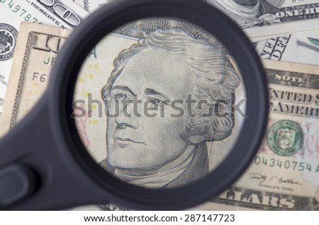 Alexander Hamilton on ten dollar United States as a background - stock photo
