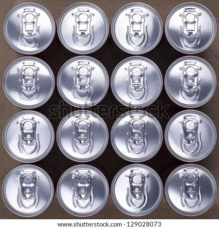 16 aligned drink cans. Top view. - stock photo