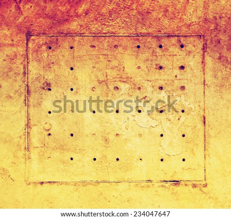 an abstract background with holes and grunge marks toned with a retro vintage instagram filter  - stock photo