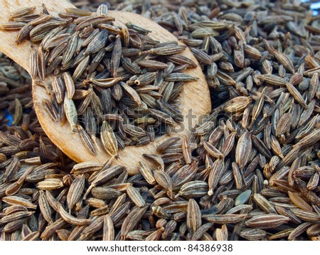 An image of Indian cumin seeds in a spoon - stock photo