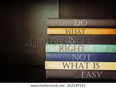 an inspirational quote by unknown source on blue background with a stack of books  - stock photo
