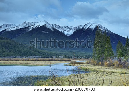 """""""An October Dusting of Snow' A dusting of snow on Mount Bourgeau, west of the Vermilion Lakes near Banff, Alberta in the Canadian Rocky Mountains. - stock photo"""