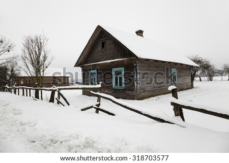 an old abandoned house in the village. Belarus. Winter. - stock photo