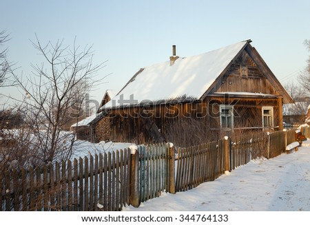 an old house in the village. Belarus. Winter. - stock photo