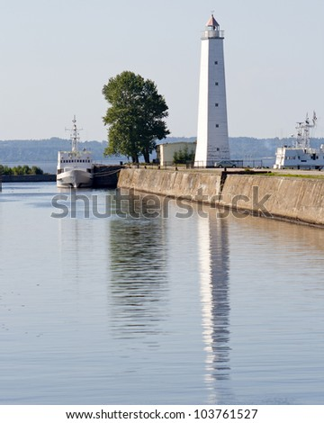 An old white lighthouse on the Baltic coast - stock photo
