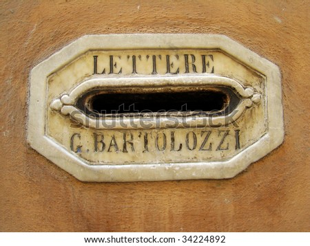 ancient  letter box in Italy - stock photo