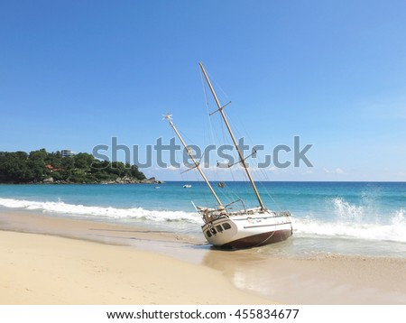 Ancient shipwrecks on the beach with  background blue color tone.                             - stock photo
