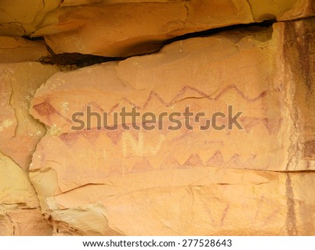 ancient snake  pictograph in sego canyon, utah       - stock photo