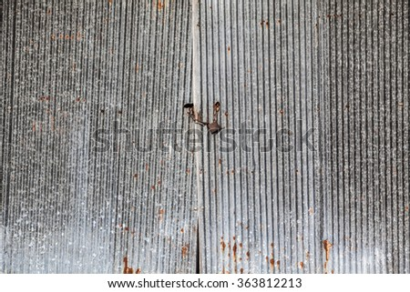 And symbols scratched the surface of the zinc walls. - stock photo