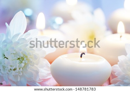 ?andles and flowers on wooden table - stock photo