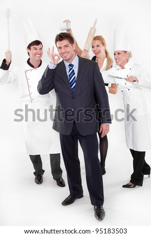 Angry restaurant staff attack a manager behind his back - stock photo
