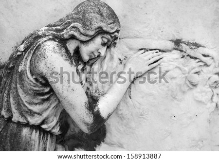 antique bas - relief  with sleeping angel on cemetery  San Michele, Venice, Italy, Europe - stock photo