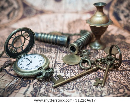 Antique Items On Ancient World Map. - stock photo