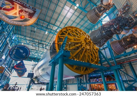 [2014-12-14]Apollo/Saturn V Center at Kennedy Space Center, Orlando, Florida. This is the rocket used to go to the moon in 1969. Rockets and visitors are visible in the photo. - stock photo