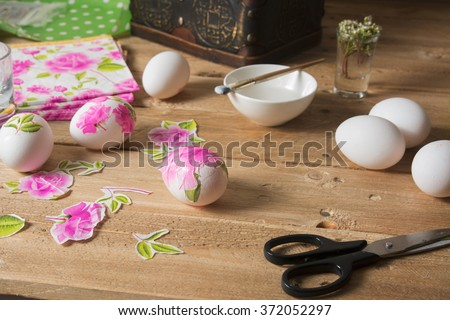 apply glue on colored Easter egg, with the technique of decoupage - stock photo