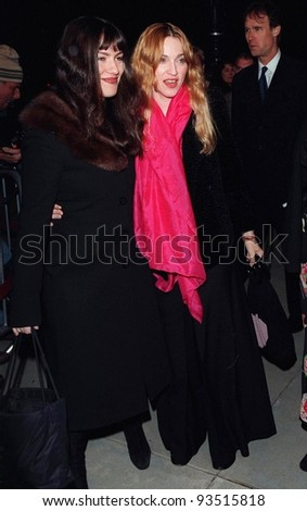 "01APR98:  Pop star/actress MADONNA with MTV presenter JULIETTE HOHNEN at the premiere of Bruce Willis' new movie, ""Mercury Rising,"" at the Academy Theatre in Beverly Hills. - stock photo"