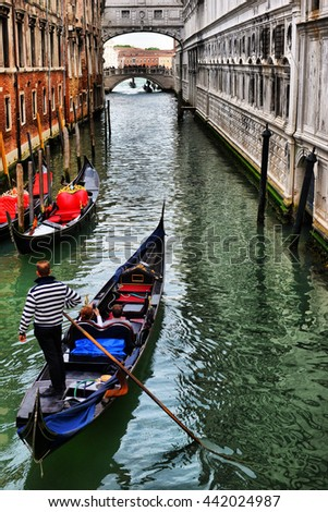 2016, APRIL, 18, Italy, Venezia, Gondolas on canal in Venice, 2016, APRIL, 18, Italy, Venezia - stock photo