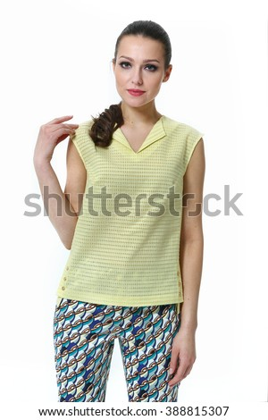 arabian asian eastern brunette business executive woman pony tail with straight hair style in yellow summer sleevesess tshirt and trousers high heel shoes standing full body length isolated on white - stock photo