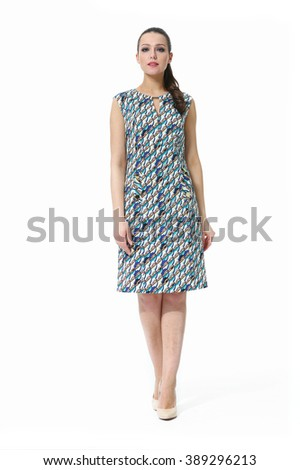 arabian asian eastern brunette business executive woman with straight hair style in printed ethnic summer dress high heel shoes standing full body length isolated on white - stock photo