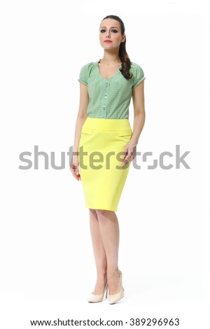 arabian asian eastern brunette business executive woman with straight hair style in summer blouse and yellow skirt high heel shoes standing full body length isolated on white - stock photo