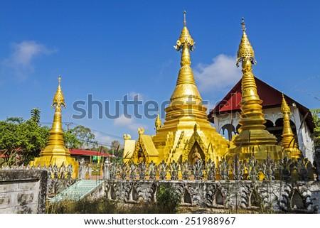 Architecture and blue sky at Wat Som Det Temple, Sangkhla Buri, Kanchanaburi Province , Thailand - stock photo