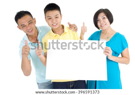 Asian family holding blank white board on white background. - stock photo