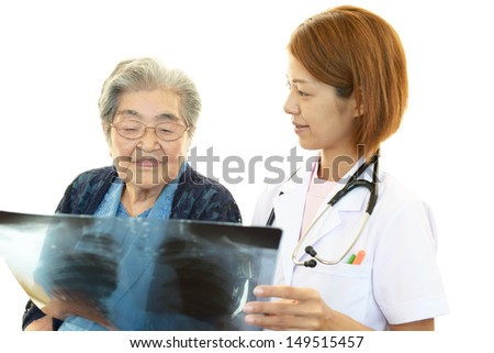 Asian medical doctor and old woman - stock photo