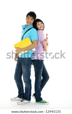 2 Asian young woman and standing with book and bags - stock photo
